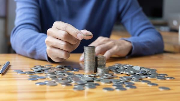 Coins spread on a table.